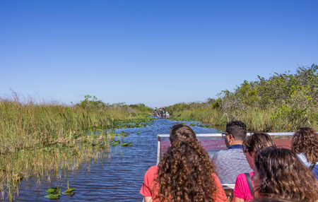 permits: EVERGLADES - NOVEMBER 30,2013:  tourists on airboat.Everglades National Park in South Florida has stopped issuing new permits for private airboats