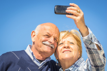 old couple taking a selfie photo