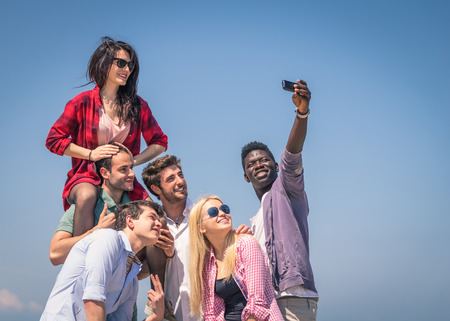 group of friends make a selfie photo