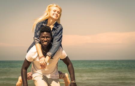 interracial couple on the beach photo