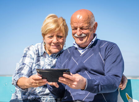 old couple with tablet photo