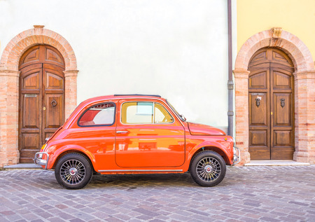RIMINI,ITALY - MAY 17,2014: Fiat 500 car on the street. Fiat 500 is among Top 50 cars in automotive history. Nowadays it is desired by collectors.