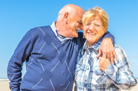 dignity: Senior couple hugging and smiling Stock Photo