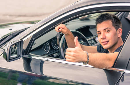 car loans: happy man in his car Stock Photo