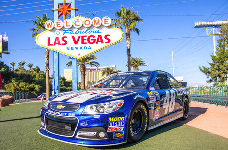 lasvegas: LAS VEGAS - DECEMBER 6: Chevrolet racing car number 48 representing the NASCAR championship  in front of the famous Welcome Sign on December 6, 2013 in Las Vegas.Nascar races are the most followed sport event after Super Bowl. Editorial