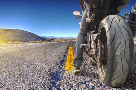 motorcyclist: Road crossing the Death Valley