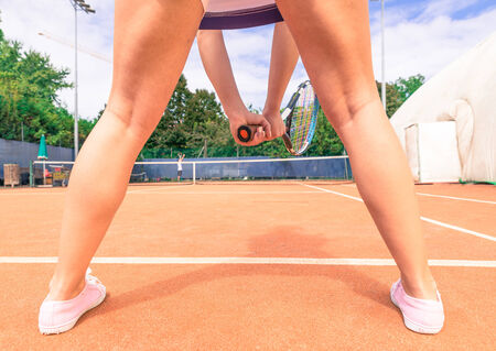 legs open: tennis player rear view