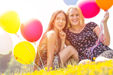 two beautiful girls with balloons photo