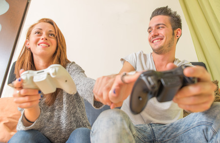 young couple playing videogames photo