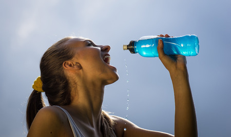thirsty athlete drinking power drink