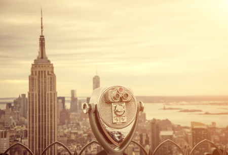 sunshine state: Aerial view of Manhattan from a Binocular Editorial