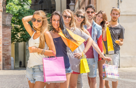Group of friends holding shopping bags photo