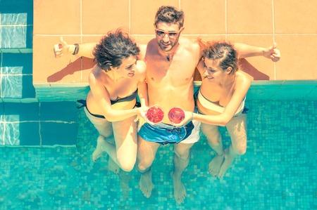 Friends having fun in a swimming pool photo