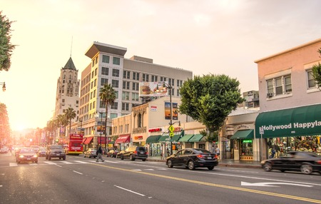 fame: LOS ANGELES - DECEMBER 18, 2013: View of Hollywood Boulevard at sunset. In 1958, the Hollywood Walk of Fame was created on this street as a tribute to artists working in the entertainment industry Editorial