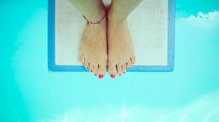 springboard: chica en el trampolín Foto de archivo