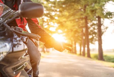 バイクに乗る人の挨拶 写真素材