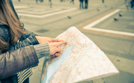 tourists with map Фото со стока