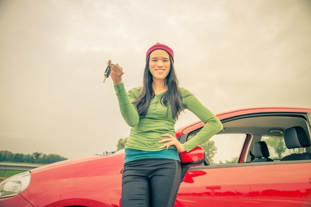Asian woman with car keys - Pretty girl showing keys after buying a new car