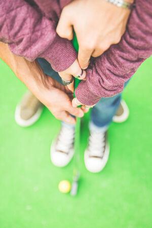 teen golf: par de mini juego de golf Foto de archivo