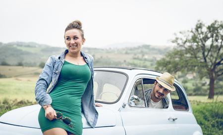 flirting on a vintage car photo