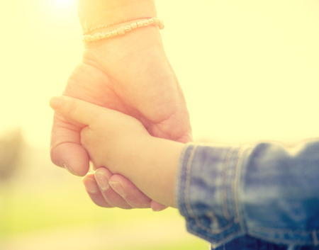 father holding daughter hand Stock Photo