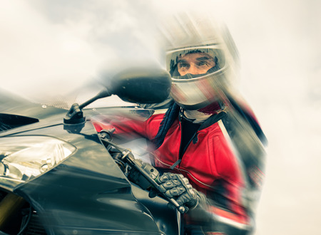 moto: biker riding fast with the motorcycle