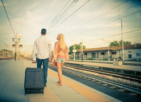 goodbye: Couple at train station - Last goodbye before the train arrives Stock Photo