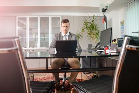 lawer: Business man working on computer desk
