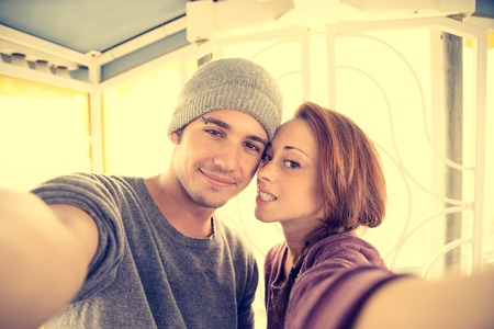 lovers: Couple taking a selfie on a panoramic wheel - Lovers having fun at amusement park Stock Photo