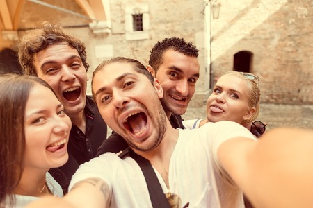 taking photograph: Group of friends taking a selfie - Tourists taking a photograph on a day trip Stock Photo