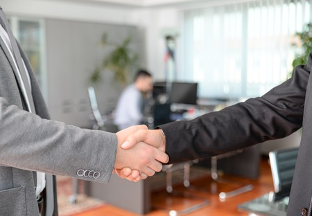 lawer: Handshake in the office - Business man working on computer desk