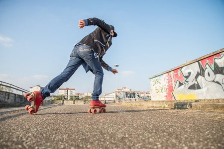Cool man with roller skating shoes running - Concepts of youthness,sport,lifestyle and 80s vintage style Editorial