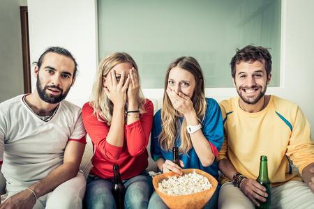 sofa television: horror movie in tv Stock Photo