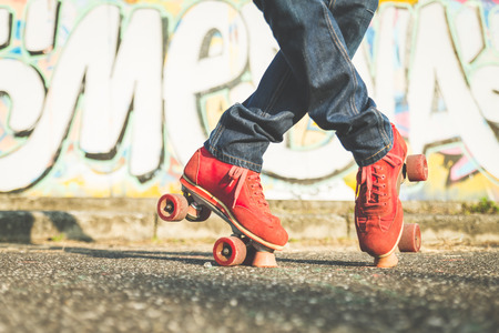 adult 80s: roller-skating position Stock Photo