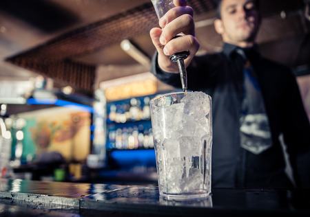bartender: bartender in action Stock Photo