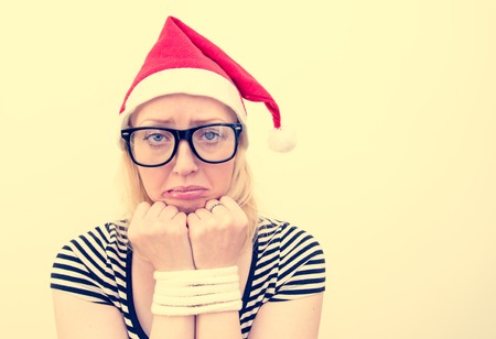 tied girl: Woman with Santas hat 0- Sad girl with tied up hands