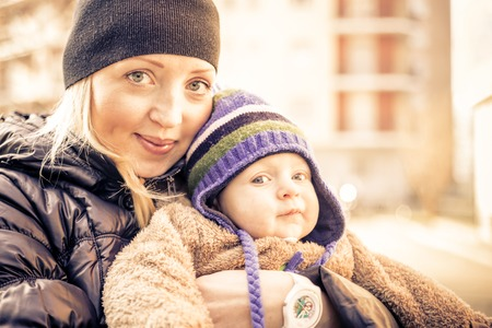 Mom and her handsome son - Woman and baby outdoors photo