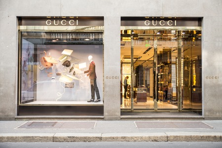 gucci store: MILAN,ITALY - DECEMBER 30, 2014 : Gucci boutique in Monte Napoleone ave,Milan.Gucci is a world famous fashion brand.