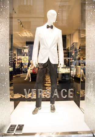 awnings windows: MILAN,ITALY - DECEMBER 30, 2014: mannequin exposed on Versace boutique window.Versace is a world famous fashion brand.