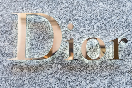 light duty: MILAN,ITALY - DECEMBER 30, 2014: Dior logo on a boutique shop.Dior is a world famous fashion brand.