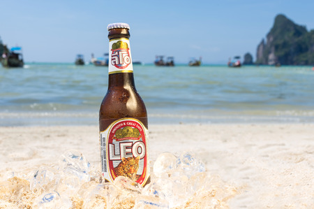 phi phi: PHI PHI ISLAND,THAILAND - FEBRUARY 27,2015: Leo beer on the beach.Leo beer created by boon rawd brewery co.,ltd in Thailand