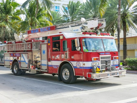 firetruck: MIAMI,FL  - DECEMBER 2, 2013: Fireman truck on the streets.Firefighters patrol streets of Miami Editorial