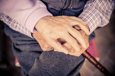 oldness: Senior couple hands - Aged woman holding her husban hands - Concepts about oldness,consolation and lifestyle
