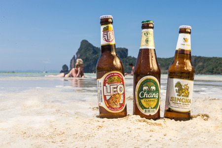 phi phi: PHI PHI ISLAND,THAILAND - FEBRUARY 27,2015: Chang,Singha and Leo beer are the most famous beer and produced by Asias largest beverage companies