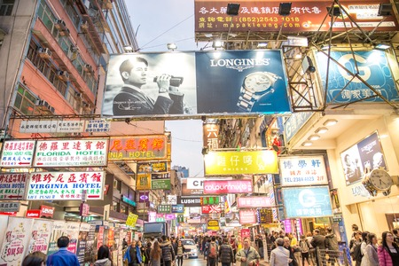 market place: HONG KONG - FEBRUARY 12,2015:  Signs illuminate the night in Mong Kok. Hong Kong is well known for the myriad of neon lights located above the roadways.