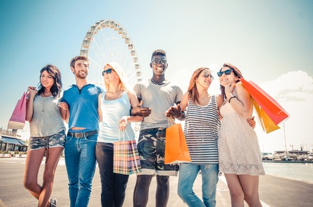 people having fun: Group of friends holding shopping bags - Multiracial group of young people having fun after shopping