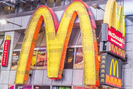 times square new york: NEW YORK - DECEMBER 22, 2013: sign-logo of the chain Mc Donalds  in Times Square,New York.