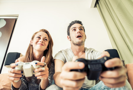 couch: couple playing vieo games Stock Photo
