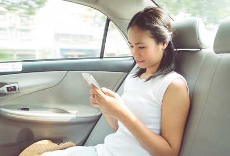 asian woman in the taxi