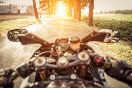 rearing: motorbike rearing in the sunset